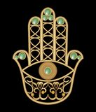 Golden Miriam hand with eye shape in filigree design with green  emerald gem, amulet of protection Stock Image
