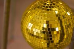 Golden mirror disco ball on a dark background royalty free stock photos