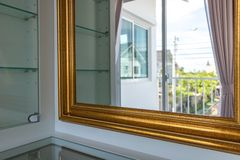 Golden mirror frame in dressing room Royalty Free Stock Image