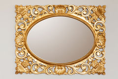 Golden mirror frame. On the wall Royalty Free Stock Images