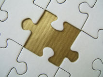 Golden missed element. Of a jigsaw Royalty Free Stock Image