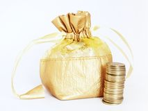 Golden Money Bag with Stack of Gold Coins. Golden money bag with a stack of golden Indian currency coins, isolated on white. Suitable for wealth building and Royalty Free Stock Photography