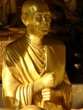 Golden monk statue. Golden statue of a revered monk in Thailand royalty free stock image