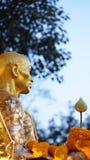 Golden monk statue in thailand Stock Photos