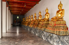 GOLDEN MONK STATUE AT WAT PHO. This statue is a Buddhist sculptures Royalty Free Stock Photography