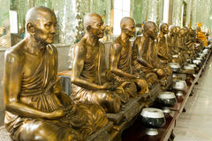 Golden monk statues Stock Images