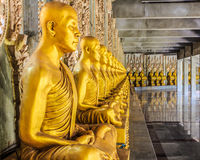 Golden monk statues. Stock photo stock image