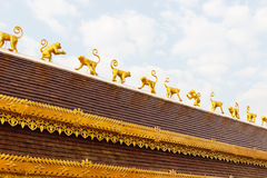 Golden monkey sculpture decorating on temple roof Stock Photography