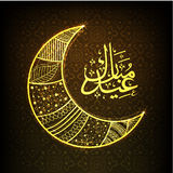 GOlden moon and Arabic text for Eid festival celebration. Stock Images