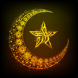 Golden moon, Arabic text and star for Eid Mubarak. Stock Photography