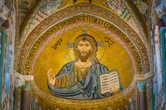 Golden mosaic with Christ Pantocrator in the apse of Cefalù Cathedral. Sicily, southern italy. stock image