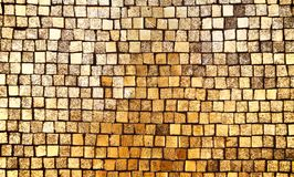 Golden mosaic wall background Royalty Free Stock Image