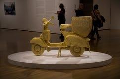 Golden motorbike artwork museum Stock Image