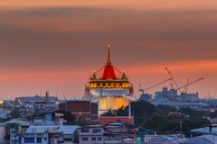Golden Mount Temple Fair, Golden Mount Temple with red cloth in Bangkok at dusk. Wat Sraket, Thailand Stock Images
