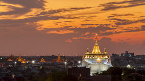 Golden Mount Temple Fair, Golden Mount Temple with red cloth in. Bangkok at dusk (Wat Sraket, Thailand Stock Photography