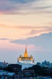 Golden mount temple (wat sraket rajavaravihara) at sunset Stock Images