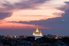 Golden mount temple (wat sraket rajavaravihara) at sunset Royalty Free Stock Photography