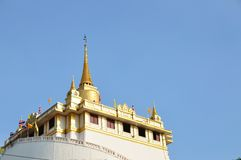Golden mount of Wat Sakret Temple with blue sky Stock Photos