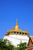 Golden mountain, an ancient pagoda at Wat Saket Stock Photo