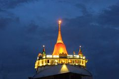 Golden mountain cloaked in orange during festival Royalty Free Stock Photo