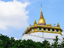 Golden Mountain. Golden Mountain is located at Wat Saket Bangkok countries Thailand. Thailand is a tourist attraction for local people and foreigners Royalty Free Stock Images