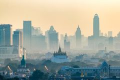 Golden Mountain Pagoda, an ancient temple, Wat Saket in Bangkok. In the morning behind a high-rise business district Stock Images