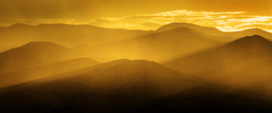 Golden Mountains in Morning or Evening Light Sunlight Panorama Stock Photo