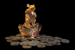 Golden mouse with coins. A golden mouse are holding greeting signs with coins - isolated over black space Stock Photos