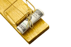 Golden mousetrap with rolled dollar bait stock image