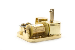 Golden music box. Golden music toy isolated on white background Royalty Free Stock Photo