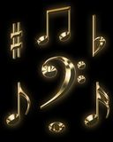 Golden music signs. Isolated on black Stock Images