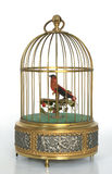Golden musical bird cage with red bird. This is a vintage brass musical cherub bird cage from Germany from the 1960s Royalty Free Stock Images