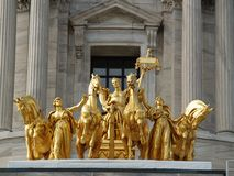 Golden mythological statue Royalty Free Stock Photo