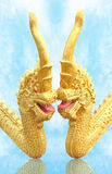 Golden naga on blue sky. Stock Images