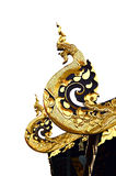 Golden naga image on thai temple roof. Isolate on white Stock Images