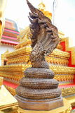 Golden Naga. King of naga 7  headed   bronze casting at Wat Phra That Phanom in Nakhon Phanom province in northeastern Thailand Stock Images