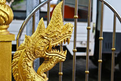 Golden Naga ladder sculpture in Lao temple. Laos Royalty Free Stock Photo