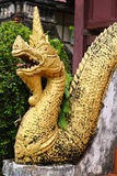 Golden Naga ladder sculpture in Lao temple. Laos Royalty Free Stock Photography