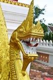 Golden Naga ladder sculpture in Lao temple. Laos Stock Images