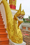 Golden Naga ladder sculpture in Lao temple. Laos Royalty Free Stock Images