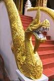 Golden Naga ladder sculpture in Lao temple. Laos Stock Photo