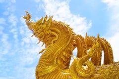 Sculpture in Thai(The Golden Naga) Stock Photo
