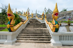 Golden naga snakes on staircases of buddhist temple in Thailand Royalty Free Stock Photography