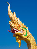 Golden Naga Statue with clear blue sky, Udonthani, Thailand Royalty Free Stock Photos