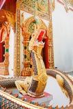 Golden Naga statue Stock Image