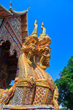 Golden Naga statue at the stairs in the temple Royalty Free Stock Photography