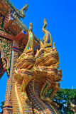 Golden Naga statue at the stairs in the temple Stock Photos
