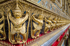 Golden Nagas. Gold ornamental patter statuettes. Ancient sculpture works. Wat Phra Kaew, Temple of the Emerald Buddha is famous te. Gold ornamental patter royalty free stock photos