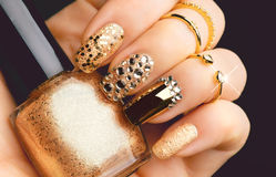 Golden Nail Art Manicure With Gems And Sparkles Stock Photo