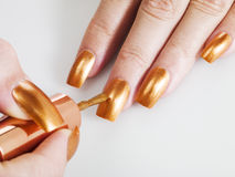 Golden nail polish Royalty Free Stock Photo